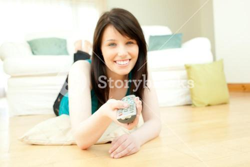 Brunette woman watching television