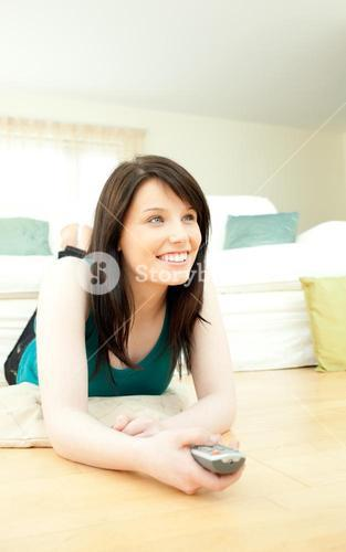 Attractive woman watching television