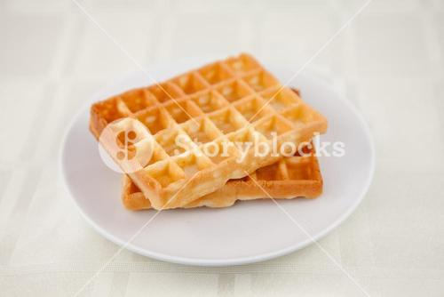 Two waffles on a saucer