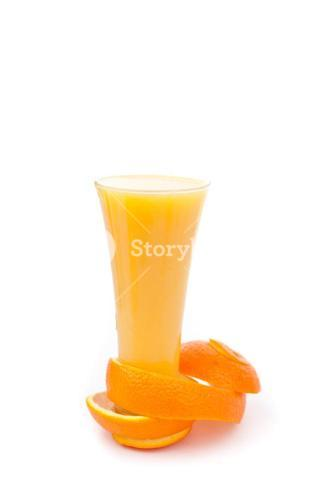 orange peel at the base of a full glass