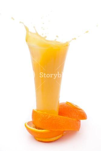 orange peel surrounded around a overflowing glass