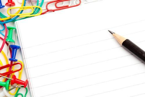 Notepad with large group of muti coloured stationery and a pencil