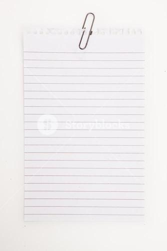 Blank page with grey paperclip