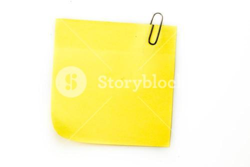 Sticky note with grey paperclip