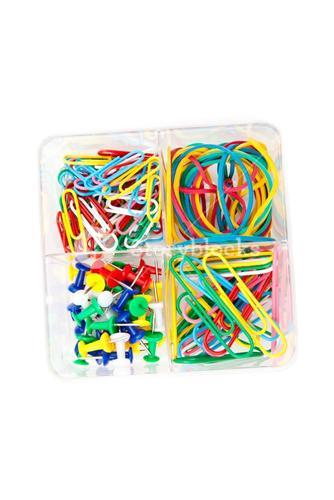 Box of multicolored of pushpins paperclips and elastics
