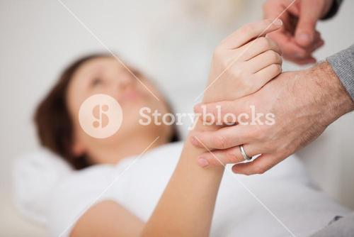 Hand of a woman being manipulated