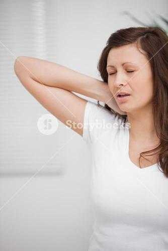 Woman touching her painful neck