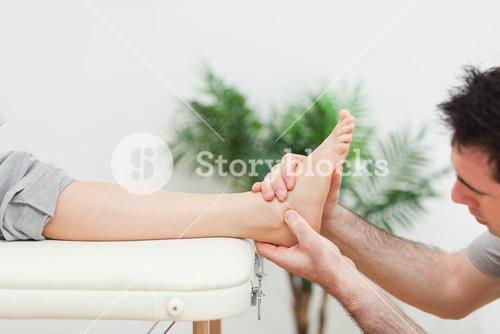 Close up of a doctor massaging a foot