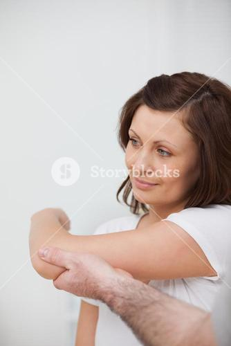 Smiling woman being stretched by a man