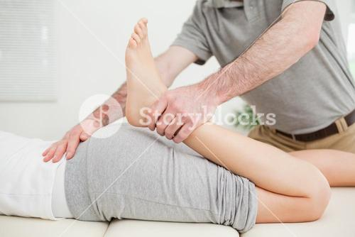 Close up of a woman lying while being stretched