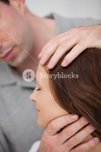 Close up of a doctor examining the neck of a patient
