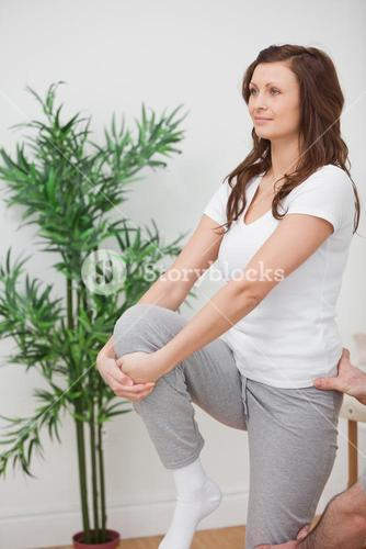 Woman standing while stretching her leg