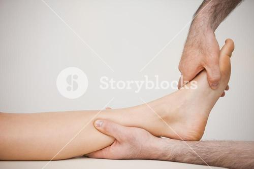 Side view of a foot being massaged