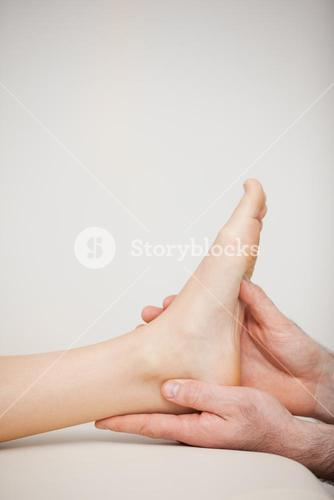 Close up of a foot being held by a doctor