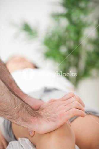 Serious doctor pressing on the knee of a woman