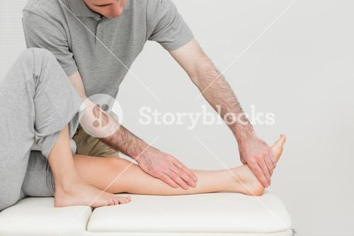 Calf of a patient being stretched by a doctor
