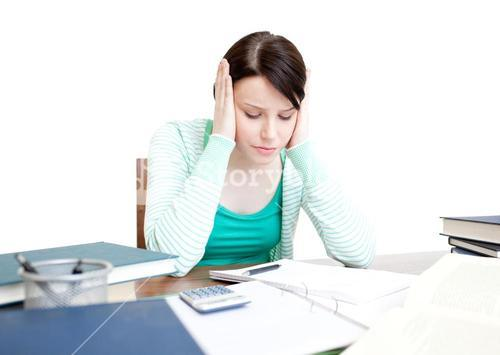 Stressed student doing her homework