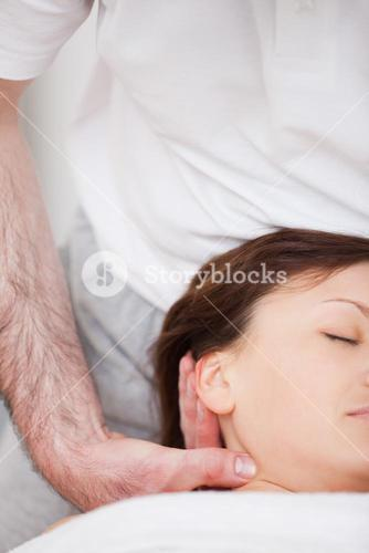 Close up of woman being manipulating by a therapist