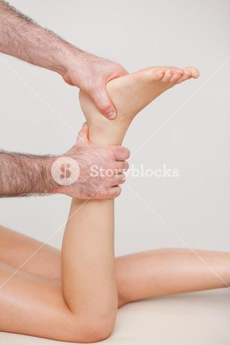 Podiatrist manipulating the ankle of his patient