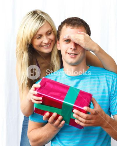 Woman giving a present to her boyfriend