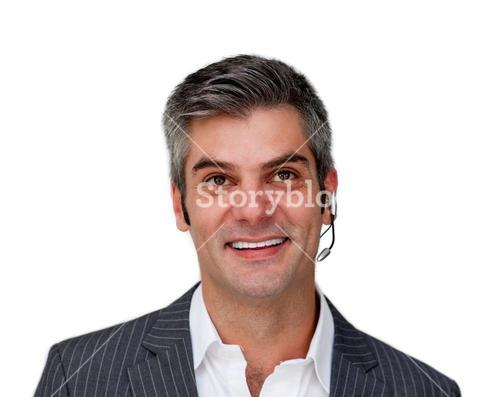 Assertive businessman using headset