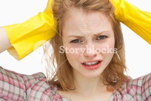 Close up of a woman pulling her hair