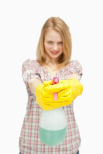 fairhaired woman holding a spray bottle
