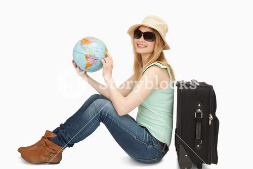 Woman holding a world globe while smiling