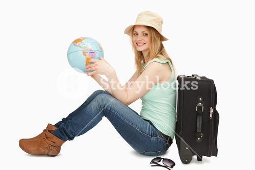 Woman smiling while holding a world globe