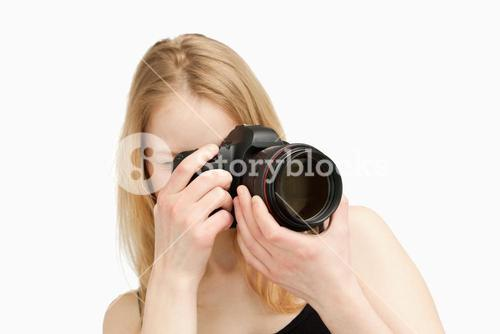 Woman taking a photography with a singlelens reflex camera