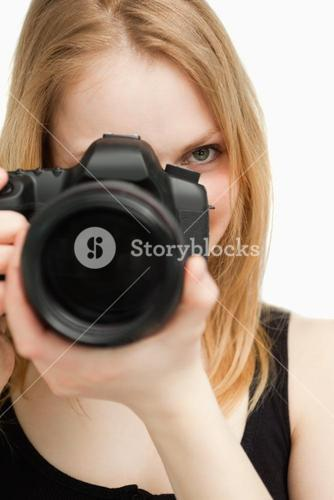 Close up of a woman holding a camera
