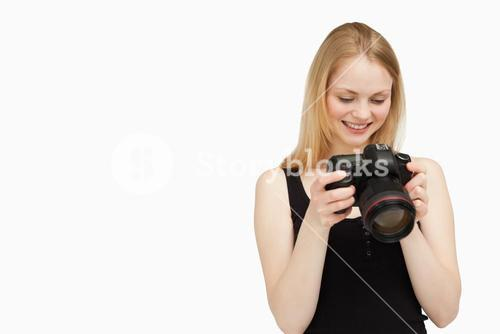 Cheerful woman looking at her camera