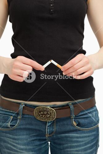 Woman breaking a cigarette with her hands