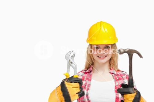 Woman smiling while wearing a safety helmet