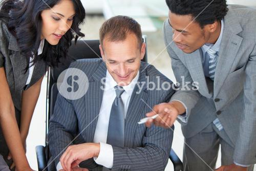 Manager with employees working in office
