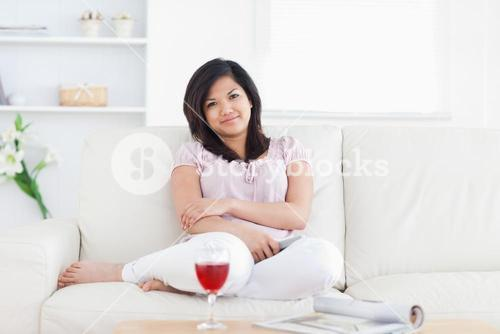 Woman smiling while sitting on a couch