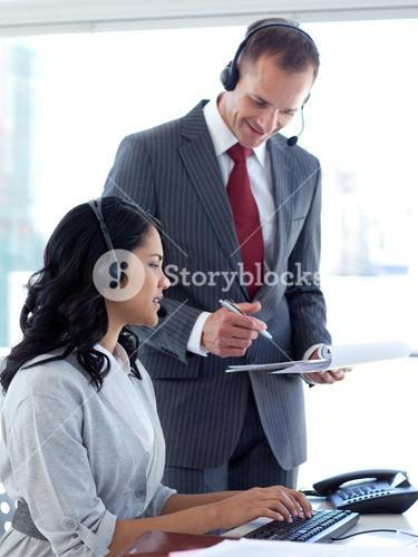 Manager talking to an businesswoman in a call center