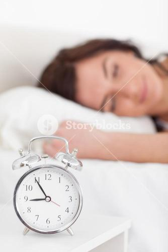 Alarm clock being placed on a nightstand