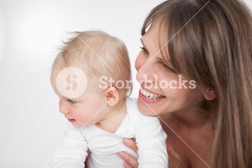 Laughing woman holding her cute daughter