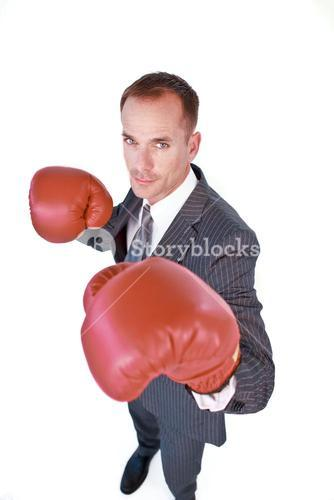 Selfassured businessman wearing boxing