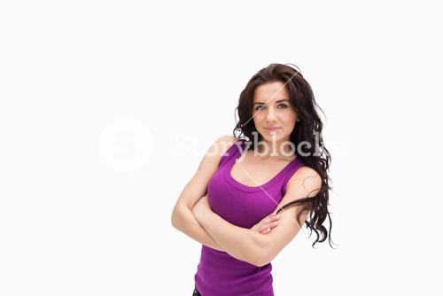 Brunette with arms crossed in purple tank top