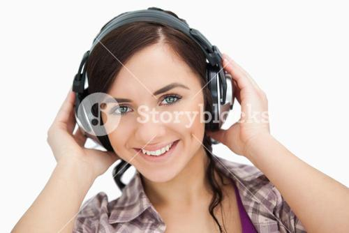 Blue eyed woman wearing headphones