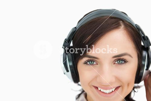 Woman with beautiful eyes wearing headphones