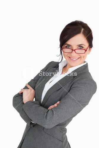 Attractive blue eyed secretary with folded arms
