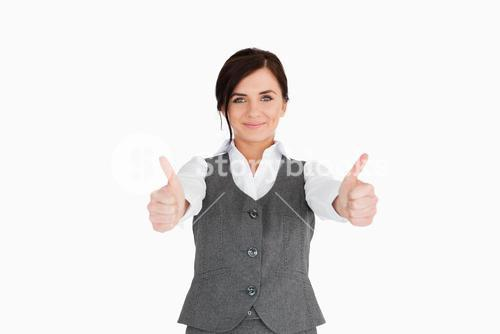 Young woman in suit the thumbsup