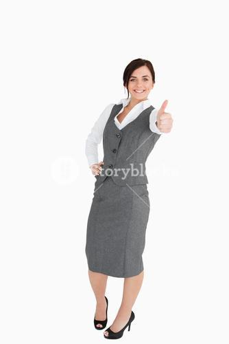Happy welldressed woman the thumb-up