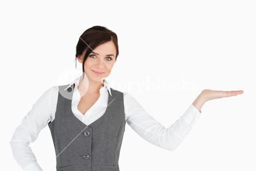 Beautiful businesswoman with her palm facing up