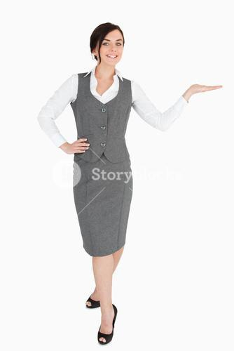 Happy welldressed woman with her palm facing upwards