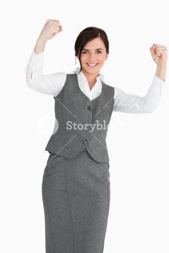 Smiling businesswoman raising her fists