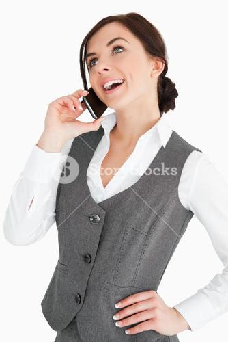 Happy welldressed woman calling with a smartphone